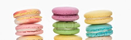 Photo for Rows of sweet colorful French macaroons of different flavors isolated on white, panoramic shot - Royalty Free Image