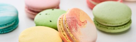 Photo for Close up view of sweet French macaroons of different flavors on white background, panoramic shot - Royalty Free Image