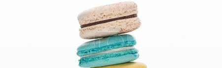 Photo for Stack of delicious colorful French macaroons of different flavors isolated on white, panoramic shot - Royalty Free Image