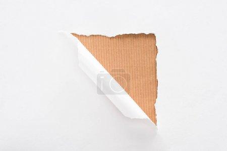 Foto de Papel blanco desgarrado y laminado sobre fondo a rayas beige - Imagen libre de derechos