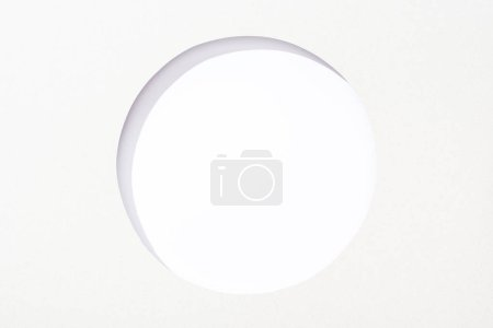 Photo for Cut out round hole in white paper on white background - Royalty Free Image