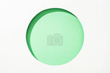 Photo pour Trou rond découpé dans le papier blanc sur le fond coloré vert lime - image libre de droit