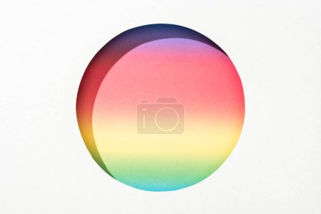 Photo for Cut out round hole in white paper on colorful rainbow background - Royalty Free Image