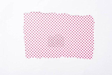 Foto de Polka punto rosa y blanco colorido fondo en el agujero de papel desgarrado blanco - Imagen libre de derechos