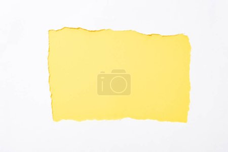 Photo for Yellow colorful background in white torn paper hole - Royalty Free Image
