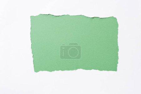 Foto de Verde fondo colorido en agujero de papel roto blanco - Imagen libre de derechos