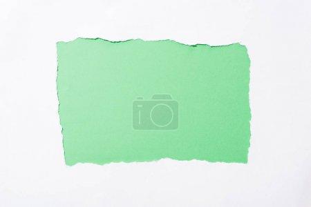 Foto de Verde brillante fondo colorido en el agujero de papel roto blanco - Imagen libre de derechos