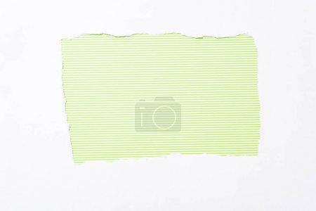Foto de Verde lima rayas colorido fondo en agujero de papel roto blanco - Imagen libre de derechos