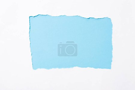 Photo for Light blue colorful background in white torn paper hole - Royalty Free Image