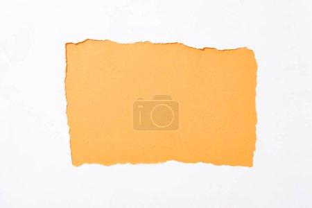 Foto de Naranja colorido fondo en el agujero de papel roto blanco - Imagen libre de derechos