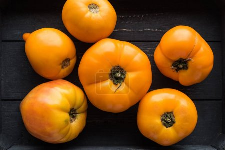 Photo for Top view of yellow tomatoes in wooden black box - Royalty Free Image