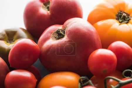 Photo for Close up view of different yellow and red tomatoes - Royalty Free Image