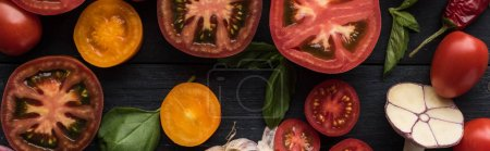 Photo for Panoramic shot of tomatoes, garlic, spinach, chilli pepper on tray on wooden table - Royalty Free Image