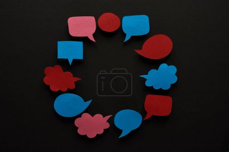 Photo for Round frame of empty speech bubbles on black background with copy space, cyberbullying concept - Royalty Free Image