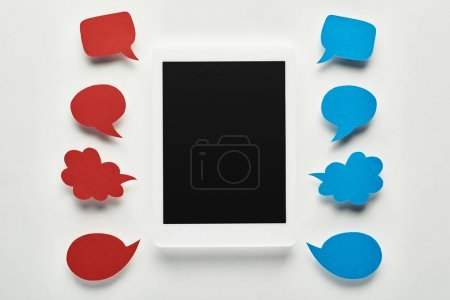 Photo for Top view of digital tablet with blank screen on white background near empty red and blue speech bubbles, cyberbullying concept - Royalty Free Image