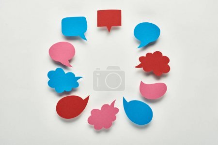 Photo for Round frame of empty speech bubbles on white background, cyberbullying concept - Royalty Free Image
