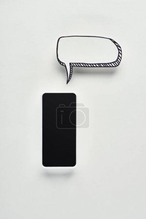 Photo for Top view of smartphone with blank screen on white background with empty speech bubble, cyberbullying concept - Royalty Free Image