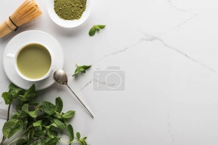 Photo for Top view of green matcha tea with mint on white table - Royalty Free Image