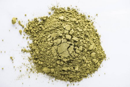 Photo for Top view of green matcha tea powder on white table - Royalty Free Image