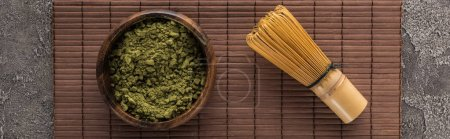 Photo for Top view of green matcha tea powder on bamboo mat on dark stone table - Royalty Free Image