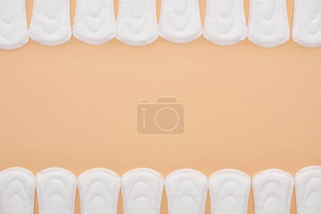 Photo for Frame of white cotton sanitary towels isolated on beige with copy space - Royalty Free Image
