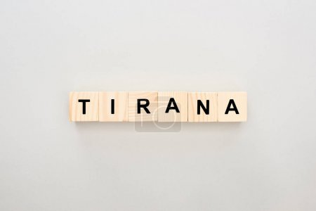 top view of wooden blocks with Tirana lettering on white background