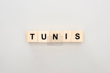 top view of wooden blocks with Tunis lettering on white background