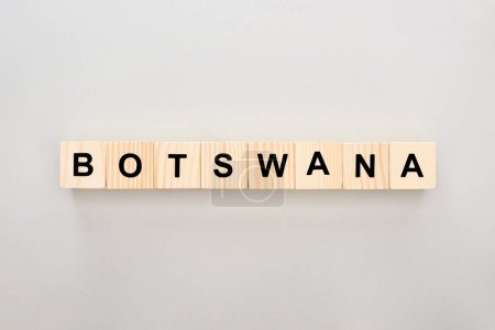 top view of wooden blocks with Botswana lettering on white background
