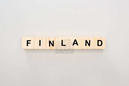 top view of wooden blocks with Finland lettering on white background