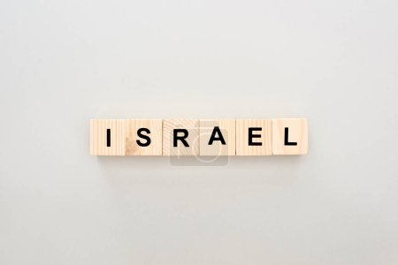 top view of wooden blocks with Israel lettering on white background