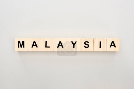 Photo for Top view of wooden blocks with Malaysia lettering on white background - Royalty Free Image