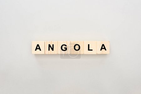top view of wooden blocks with Angola lettering on white background