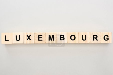 top view of wooden blocks with Luxembourg lettering on white background