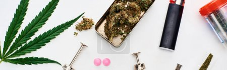 top view of marijuana buds, cannabis leaf, pills and syringes on white background, panoramic shot