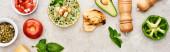 """Постер, картина, фотообои """"панорамный снимок вкусного сливочно-зеленого овощного супа возле свежих овощей на текстурной поверхности"""""""