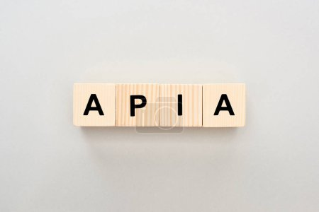 top view of wooden blocks with Apia lettering on grey background