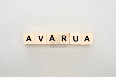 Photo for Top view of wooden blocks with Avarua lettering on grey background - Royalty Free Image