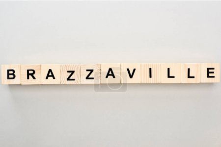 top view of wooden blocks with Brazzaville lettering on grey background