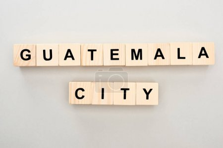 Photo for Top view of wooden blocks with Guatemala city lettering on grey background - Royalty Free Image