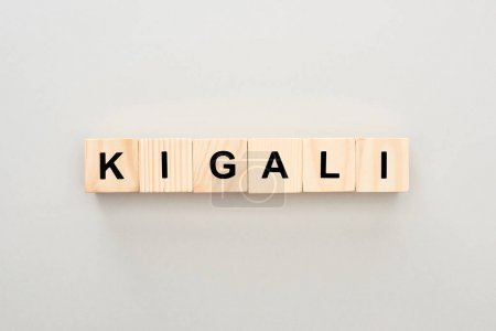 top view of wooden blocks with Kigali lettering on grey background