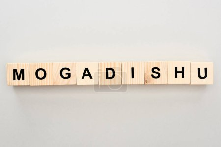 top view of wooden blocks with Mogadishu lettering on grey background