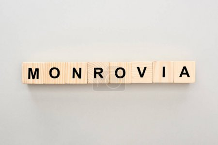 top view of wooden blocks with Monrovia lettering on grey background