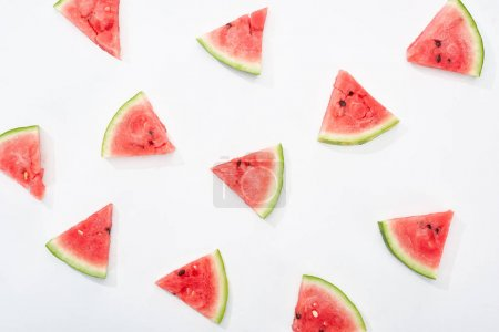 Photo for Top view of fresh watermelon slices on white background - Royalty Free Image