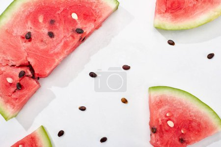 Photo for Top view of juicy watermelon slices with seeds on white background - Royalty Free Image