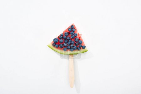Photo for Top view of delicious watermelon on stick with blueberries on white background - Royalty Free Image