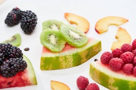 Photo for Delicious dessert with watermelon, kiwi and berries on white background - Royalty Free Image