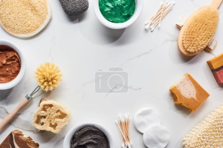 Photo for Top view of beauty products and bathroom accessories on marble surface - Royalty Free Image