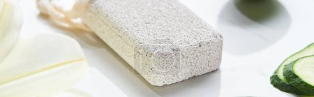 Photo for Panoramic shot of light gray pumice stone on marble surface - Royalty Free Image