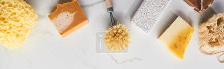 Photo for Panoramic shot of bath sponge, pumice stone, body brush, soap on marble surface - Royalty Free Image