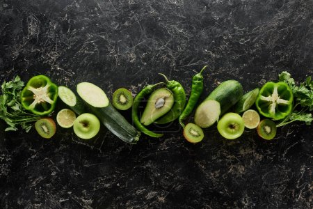 Photo for Top view of apples, avocado, cucumbers, kiwi, limes, peppers, greenery and zucchini - Royalty Free Image